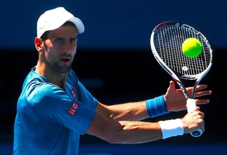 Serbia's Novak Djokovic hits a shot during a training session ahead of the Australian Open tennis tournament in Melbourne, Australia, January 12, 2017.       REUTERS/David Gray