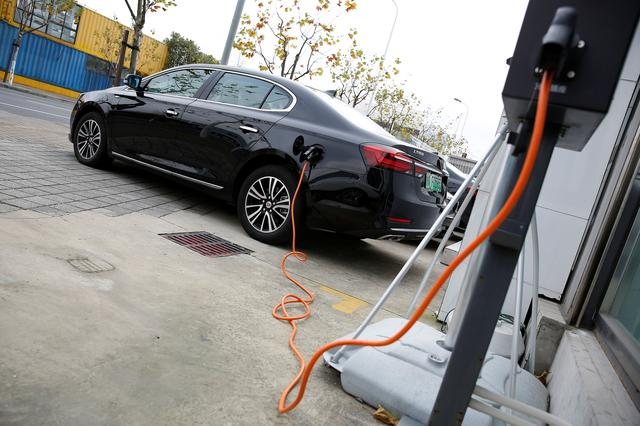 A Roewe 950 hybrid electric car is displayed with its plug-in charger at an electric car dealership in Shanghai, China, January 11, 2017. REUTERS/Aly Song
