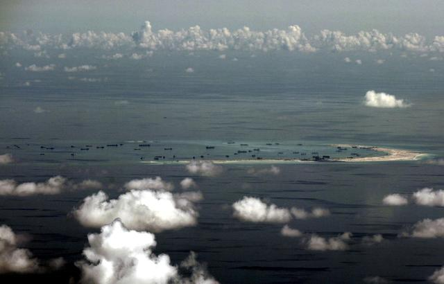 FILE PHOTO -  An aerial photo taken though a glass window of a Philippine military plane shows the alleged on-going land reclamation by China on mischief reef in the Spratly Islands in the South China Sea, west of Palawan, Philippines, May 11, 2015.  REUTERS/Ritchie B. Tongo/File Photo