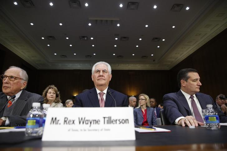 Rex Tillerson (C), former chairman and chief executive officer of Exxon Mobil, is seated prior to testifying before a Senate Foreign Relations Committee confirmation hearing on his nomination to be U.S. secretary of state, on Capitol Hill in Washington, U.S.  January 11, 2017.  REUTERS/Kevin Lamarque