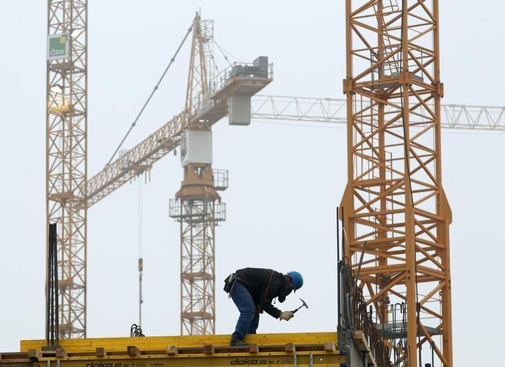 A man works at a construction site on a misty autumn day in Vienna November 20, 2012.REUTERS/Heinz-Peter Bader/Files