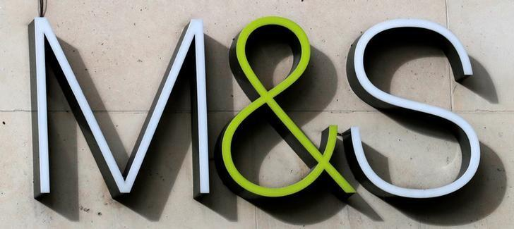 The logo of Marks & Spencer is seen in front of the store on the Champs Elysees avenue in Paris, France, November 8, 2016. REUTERS/Philippe Wojazer/Files