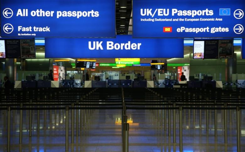 UK Border control is seen in Terminal 2 at Heathrow Airport in London June 4, 2014.   REUTERS/Neil Hall/File Photo - RTSU5Z2