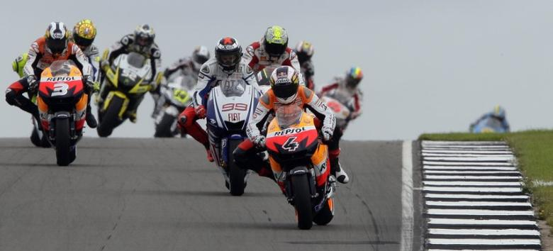 FILE PHOTO - Honda MotoGP rider Andrea Dovizioso of Italy (4) leads the British Motorcycling Grand Prix at the Donington Park circuit, central England, July 26, 2009. REUTERS/Darren Staples