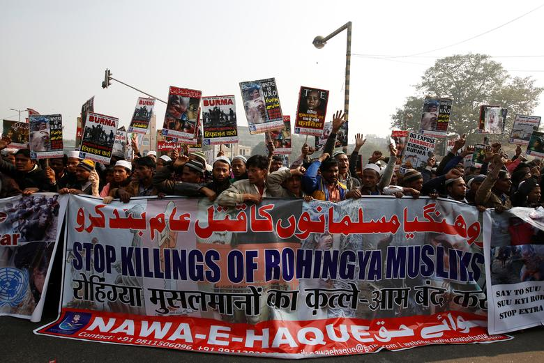 Rohingya Muslim refugees hold a banner and placards during a protest against what organisers say is the crackdown on ethnic Rohingyas in Myanmar, in New Delhi, India, December 19, 2016. REUTERS/Adnan Abidi