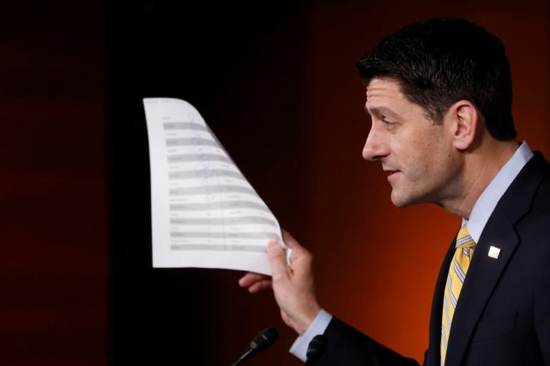 U.S. House Speaker Paul Ryan (R-WI) holds a sheet of insurance premium statistics during a news conference at the U.S. Capitol in Washington, U.S. January 5, 2017. REUTERS/Jonathan Ernst