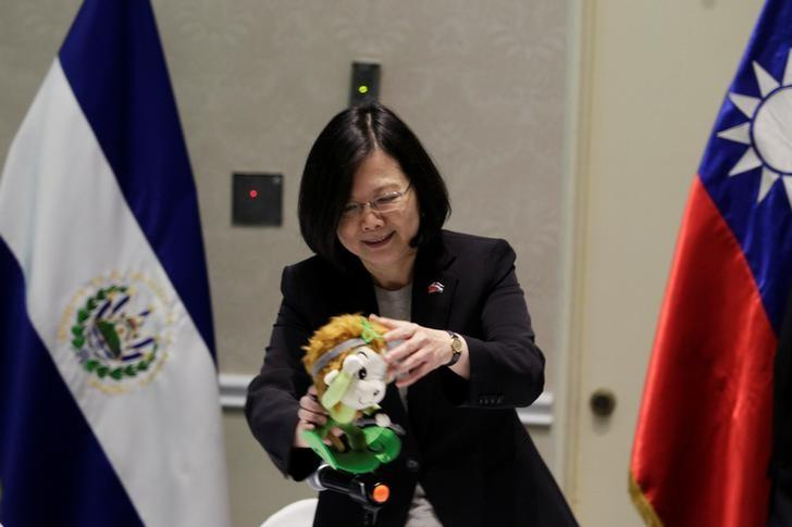 Taiwan's President Tsai Ing-wen plays with a doll during an event in San Salvador, El Salvador January 12, 2017. REUTERS/Jose Cabezas
