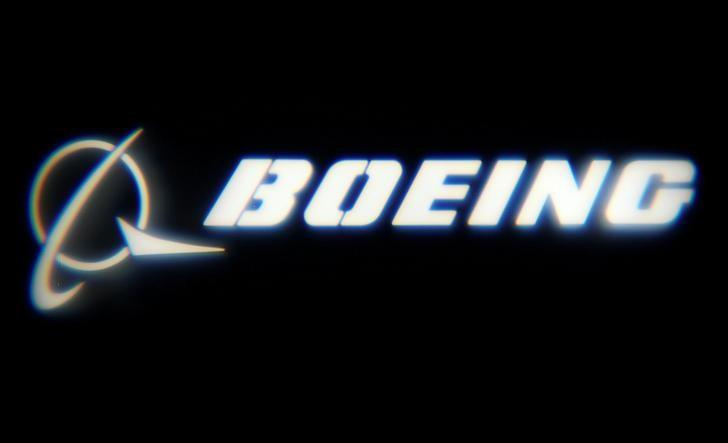 FILE PHOTO: The Boeing Company logo is projected on a wall at the ''What's Next?'' conference in Chicago, Illinois, U.S., October 4, 2016. REUTERS/Jim Young/File Photo