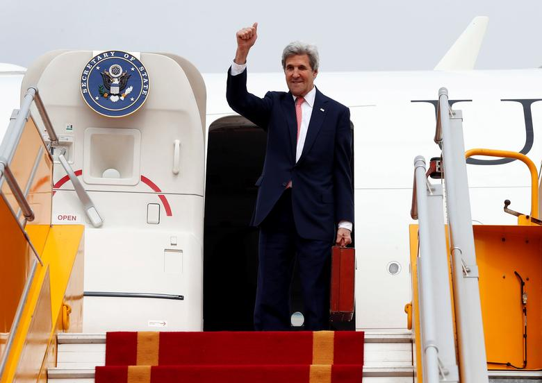 U.S. Secretary of State John Kerry waves as he boards his plane at Hanoi Airport as he departs, Friday, Jan. 13, 2017 in Hanoi, Vietnam. REUTERS/Alex Brandon/Pool