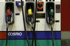 Petrol nozzles are seen at Cosmo Energy Holdings' Cosmo Oil service station in Tokyo, Japan, December 16, 2015. REUTERS/Yuya Shino/File Photo
