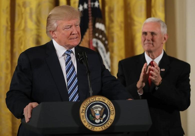 U.S. President Donald Trump attends a swearing-in ceremony for senior staff with Vice President Mike Pence at the White House in Washington, DC January 22, 2017. REUTERS/Carlos Barria