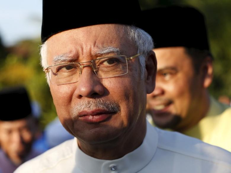 Malaysia's Prime Minister Najib Razak arrives for a news conference at a mosque outside Kuala Lumpur, Malaysia, July 5, 2015. Najib said on Sunday that he had referred ''wild allegations'' against him to lawyers and would decide any legal steps in a few days.  REUTERS/Olivia Harris        TPX IMAGES OF THE DAY      - RTX1J2V2