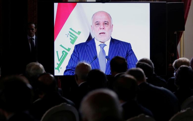 Iraqi Prime Minister Haider al-Abadi is seen on a screen as he speaks via a videoconference during a ministerial summit to hold discussion on the future of Mosul city, post-Islamic State, in Paris, France, October 20, 2016. REUTERS/Regis Duvignau