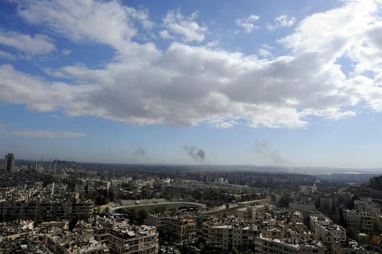 A general view shows rising smoke after strikes on Aleppo city, Syria December 3, 2016. REUTERS/Omar Sanadiki