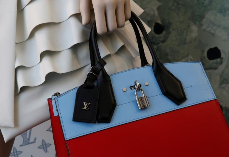 The logo of French luxury group Louis Vuitton is seen on a handbag at a store in Paris, France, January 26, 2017. REUTERS/Jacky Naegelen