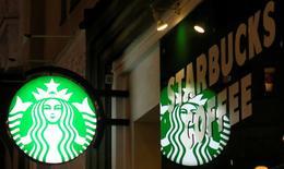 A Starbucks logo is seen at a Starbucks coffee shop in Vienna, Austria, December 27, 2016.    REUTERS/Leonhard Foeger