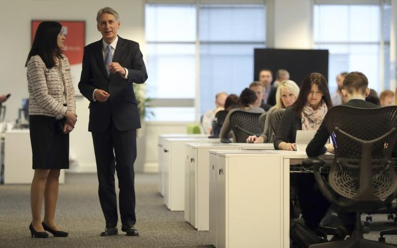 Chancellor Philip Hammond talking to Cindy Rose, Microsoft UK CEO, during a visit to the Microsoft Campus, Thames Valley Park, Reading, to coincide with the announcement later of preliminary estimates for 2016Q4 GDP, Britain, January 26, 2017. REUTERS/Andrew Matthews/Pool - RTSXG86