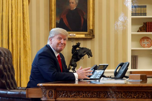 U.S. President Donald Trump waits to speak by phone with the Saudi Arabia's King Salman in the Oval Office at the White House in Washington, U.S. January 29, 2017. REUTERS/Jonathan Ernst