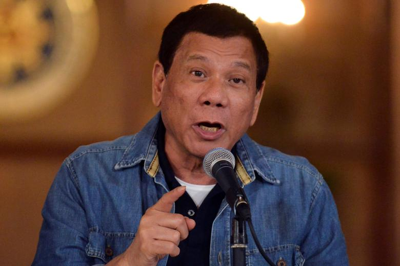 Philippine President Rodrigo Duterte gestures while speaking during a late night news conference at the presidential palace in Manila, Philippines January 30, 2017. REUTERS/Ezra Acayan