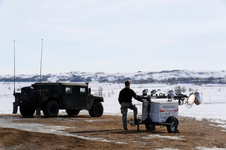 Law enforcement officers monitor the outskirts of the Dakota Access oil pipeline protest camp near Cannon Ball, North Dakota, U.S., January 29, 2017. REUTERS/Terray Sylvester