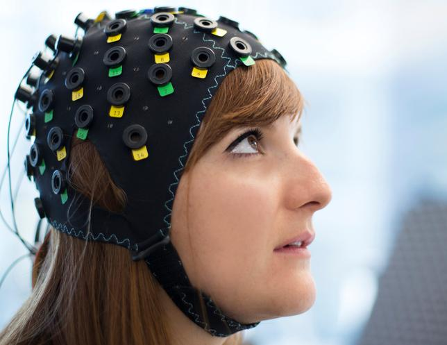 The NIRS/EEG brain-computer interface system is worn by a model in Switzerland in this undated photograph released in London, Britain, January 31, 2017. Laurent Bouvier/Wyss Centre/Handout via REUTERS