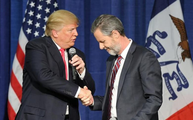 File Photo: U.S. Republican presidential candidate Donald Trump (L) shakes hands with Jerry Falwell Jr. at a campaign rally in Council Bluffs, Iowa, January 31, 2016. REUTERS/Scott Morgan/File Photo