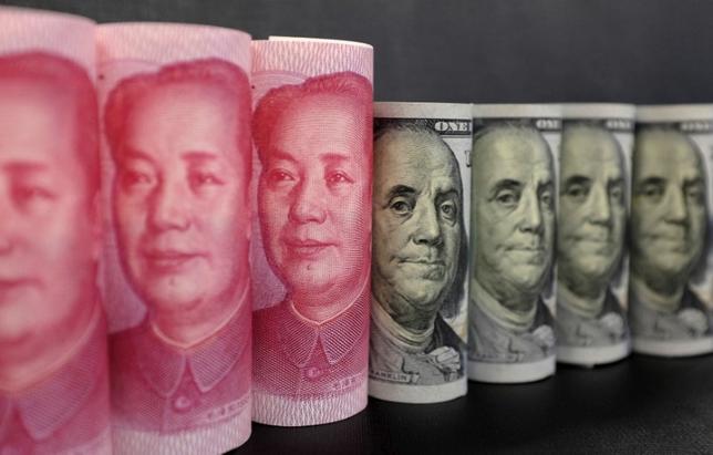 2月2日、国際金融協会(IIF)は、中国からの資本純流出額は2016年は7250億ドルと前年からネットで500億ドル増加し、過去最高を記録したと発表した。写真は2016年1月、北京で(2017年 ロイター/Jason Lee)