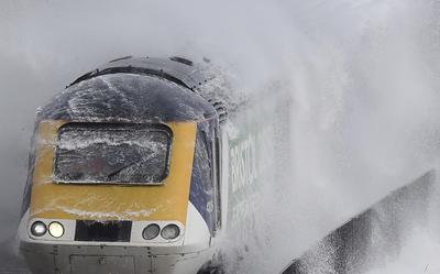 Giant waves smash British commuter train
