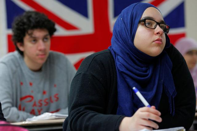 Tenth grade student Sarah Sendian listens as Nadeem Mazen, Cambridge city councillor, Muslim and founder of JetPAC, speaks to the AP Government class at Al-Noor Islamic high school in Mansfield, Massachusetts, U.S. February 2, 2017.  REUTERS/Brian Snyder