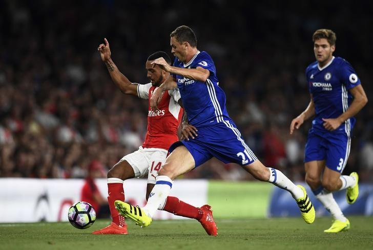 Britain Football Soccer - Arsenal v Chelsea - Premier League - Emirates Stadium - 24/9/16Arsenal's Theo Walcott in action with Chelsea's Nemanja Matic Reuters / Dylan MartinezLivepic/File Photo