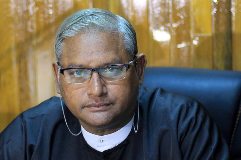 FILE PHOTO - Ko Ni, a prominent member of Myanmar's Muslim minority and legal adviser for Myanmar's ruling National League for Democracy, is seen during an interview in Yangon January 13, 2016. Ko Ni was shot dead outside the Yangon International Airport on January 29, 2017.  Phyo Thiha Cho/Myanmar Now/File photo via REUTERS