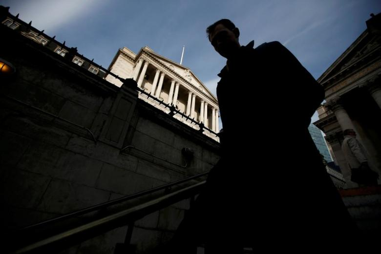 FILE PHOTO: A man walks into Bank Underground station outside the Bank of England in the City of London, Britain, November 3, 2016. REUTERS/Peter Nicholls/File Photo