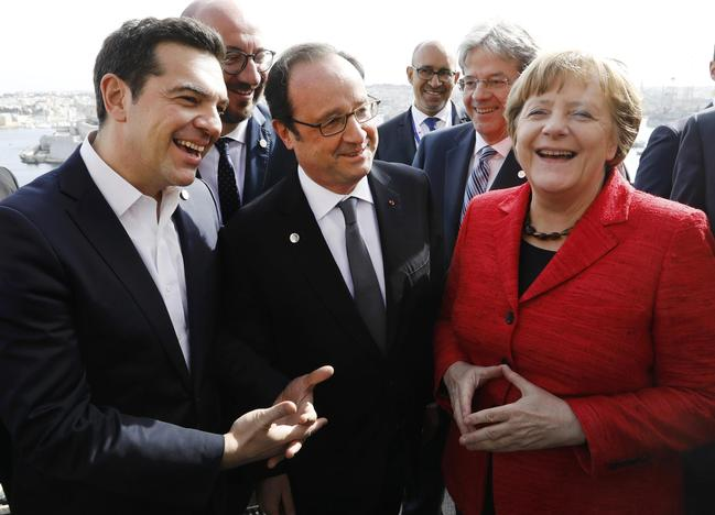 L-R, Greek Prime Minister Alexis Tsipras, French President Francois Hollande and German Chancellor Angela Merkel visit a vantage point overlooking Valletta during a break in the European Union leaders summit in Valletta, Malta, February 3, 2017. REUTERS/Yves Herman