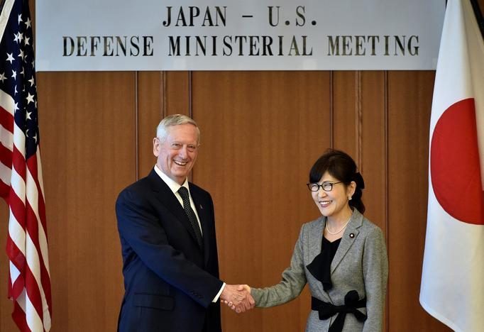 U.S. Defense Secretary Jim Mattis (L) shakes hands with Japan's Defense Minister Tomomi Inada during their meeting at the Defense Ministry in Tokyo, Japan, February 4, 2017. REUTERS/Franck Robichon/Pool