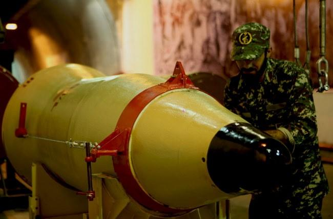 A member of the Iranian Revolutionary Guards checks a missile inside an underground depot in an undisclosed location, Iran, in this handout photo released by the official website of Islamic Revolutionary Guard Corps (IRGC) on March 8, 2016. REUTERS/sepahnews.com/Handout via Reuters