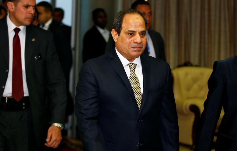 Egypt's President Abdel Fattah al-Sisi (C) is received on his arrival at the Bole International Airport ahead of the 28th Ordinary Session of the Assembly of the Heads of State and the Government of the African Union in Ethiopia's capital Addis Ababa, January 29, 2017. REUTERS/Tiksa Negeri