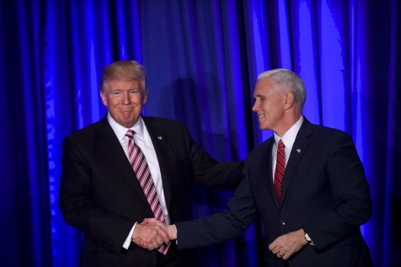 (L-R) U.S. President Donald J. Trump and Vice President Mike Pence greet one another on stage during the 2017 ''Congress of Tomorrow'' Joint Republican Issues Conference in Philadelphia, Pennsylvania, U.S. January 26, 2017.  REUTERS/Mark Makela