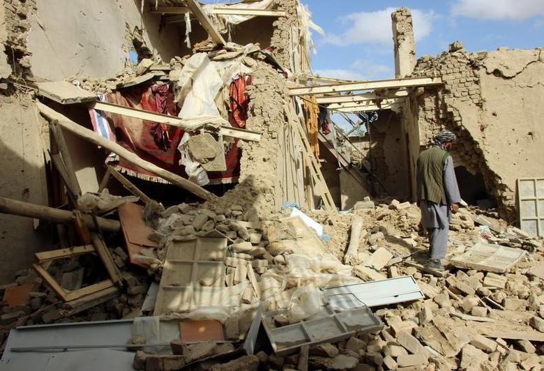 An Afghan man inspects a house destroyed during an air strike called in to protect Afghan and U.S. forces during a raid on suspected Taliban militants, in Kunduz, Afghanistan November 4, 2016. REUTERS/ Nasir Wakif