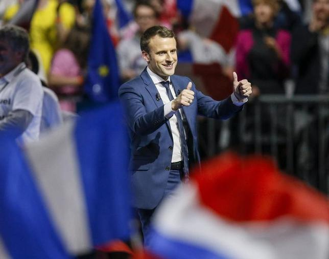 Emmanuel Macron, head of the political movement En Marche !, or Onwards !, and candidate for the 2017 presidential election, attends a campaign rally in Lyon, France, February 4, 2017. REUTERS/Robert Pratta -