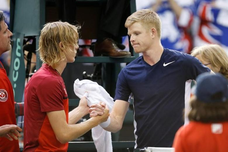 Tennis - Canada v Britain - Davis Cup World Group First Round - Ottawa, Ontario, Canada - 5/2/17. Canada's Denis Shapovalov shakes hands with Britain's Kyle Edmund (R) after defaulting in their singles match. REUTERS/Chris Wattie