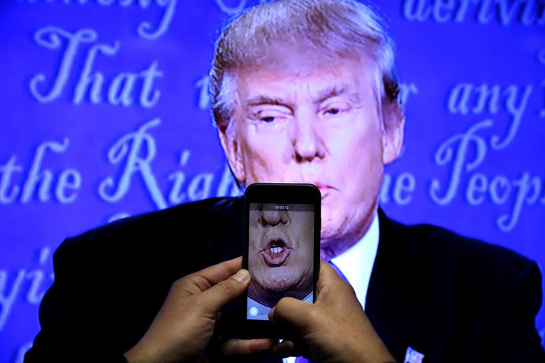 The rich and powerful are increasingly ruling social media, says columnist John Lloyd. Here Donald Trump is recorded on a journalist's smartphone during his first presidential debate with rival candidate Hillary Clinton in New York, September 26, 2016. REUTERS/Carlos Barria