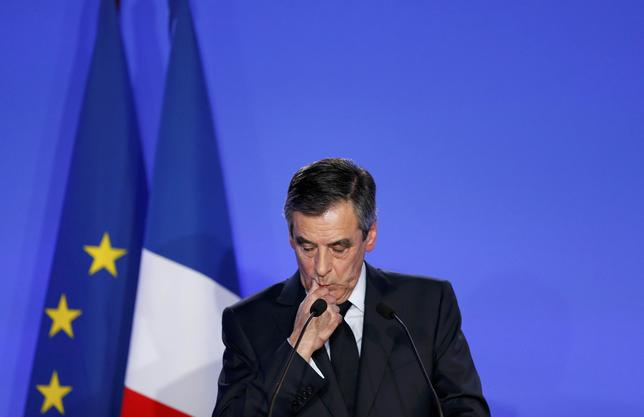 Francois Fillon, former French prime minister, member of The Republicans political party and 2017 presidential candidate of the French centre-right, reacts during a news conference about a ''fake job'' scandal at his campaign headquarters in Paris, France, February 6, 2017.   REUTERS/Benoit Tessier