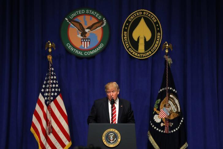 U.S. President Donald Trump speaks to commanders and coalition representatives during a visit to U.S. Central Command and U.S. Special Operations Command at MacDill Air Force Base in Tampa, Florida, U.S., February 6, 2017. REUTERS/Carlos Barria