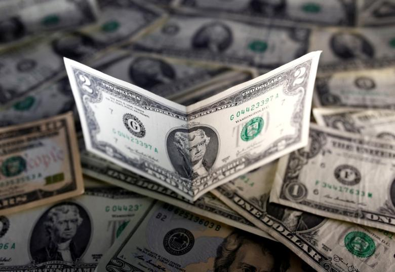 FILE PHOTO: U.S. dollar notes are seen in this November 7, 2016 picture illustration. REUTERS/Dado Ruvic/File Photo
