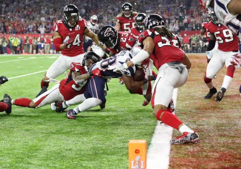 New England Patriots' James White scores a touchdown during overtime to win Super Bowl LI against the Atlanta Falcons. REUTERS/Adrees Latif