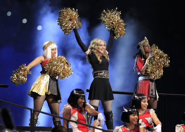 Madonna performs during the halftime show at Super Bowl XLVI between the New York Giants and the New England Patriots in Indianapolis, February 5, 2012.           REUTERS/Lucy Nicholson