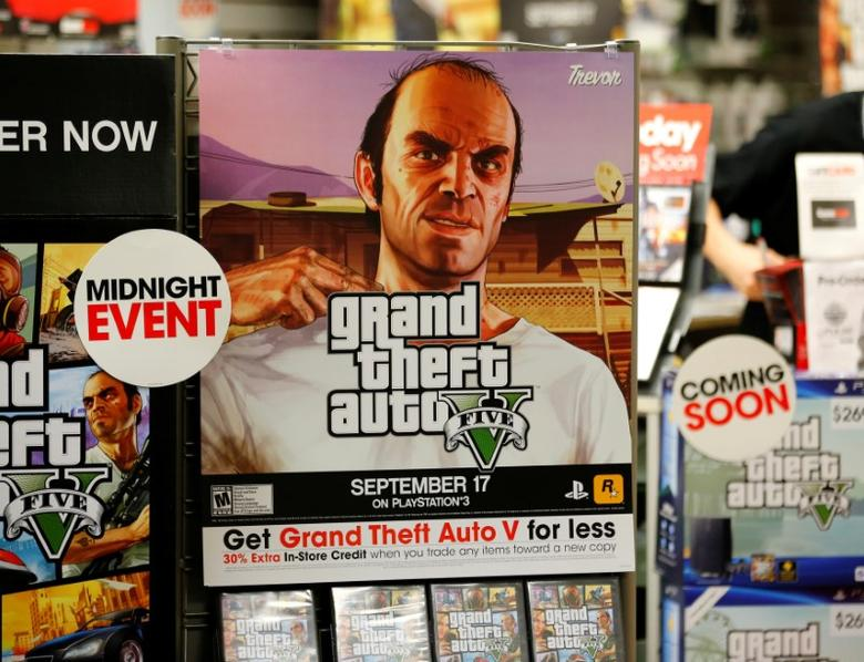 A promotion for the computer game ''Grand Theft Auto Five'' is show in a Game Stop gaming story in Encinitas, California September 17, 2013.     REUTERS/Mike Blake/File Photo