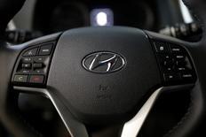 The logo of Hyundai Motor is seen on a steering wheel at its dealership in Seoul, South Korea, December 15, 2016.  REUTERS/Kim Hong-Ji