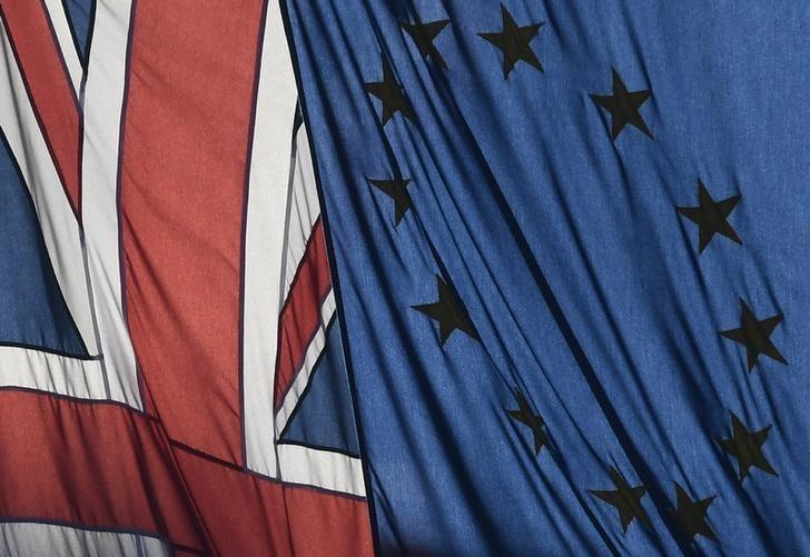 A Union flag flies next to the flag of the European Union in London, Britain, January 24, 2017.  REUTERS/Toby Melville