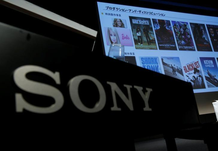 Sony Pictures movie titles on a screen are seen next to Sony Corp's logo at its executives' news conference at its headquarters in Tokyo, Japan, February 2, 2017.  REUTERS/Kim Kyung-Hoon